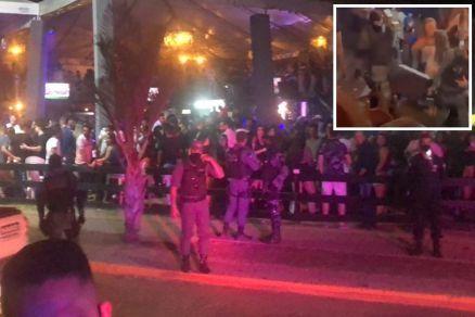 A imagem no detalhe mostra a Polícia apreendendo o som do local (Crédito: Agência da Notícia com Reprodução)